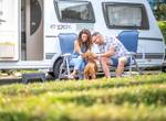 Couple in front of campervan